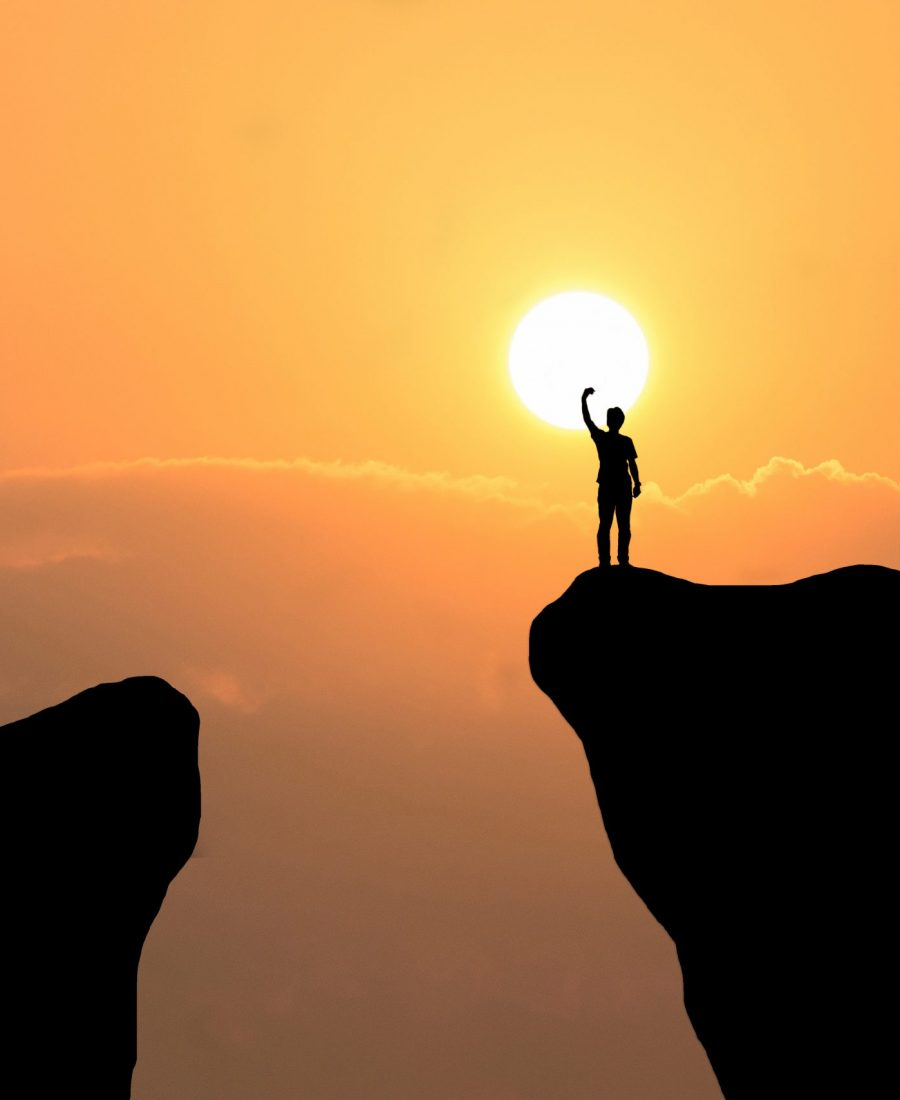 Man on top of mountain ,Freedom man on sunset background